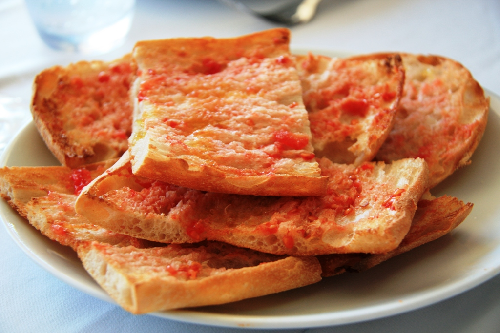 Tomato Bread is simply toasted bread rubbed with fresh garlic and ripe ...
